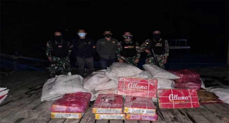 Di Tengah Malam Gelap Gulita, Prajurit TNI Gagalkan Upaya Penyelundupan Barang Ilegal